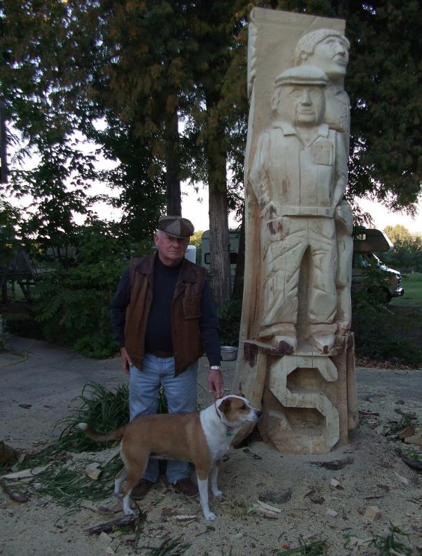 Chainsaw carving of man and dog